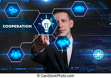 Business, Technology, Internet and network concept. Young businessman working on a virtual blackboard of the future, he sees the inscription: cooperation