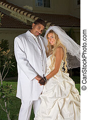 Happy new wed interracial couple in wedding mood -...