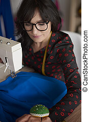 Tailor woman behind a sewing machine