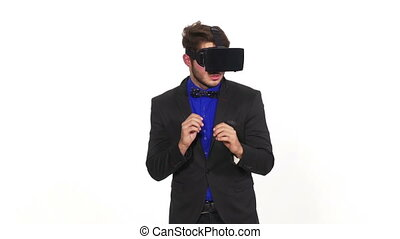 Elegant man playing a game and getting scared while wearing...