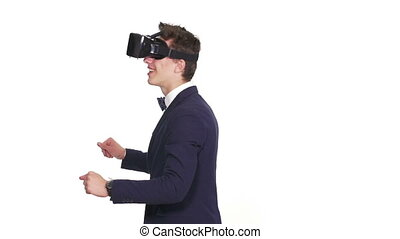 Handsome man wearing future technology virtual reality...
