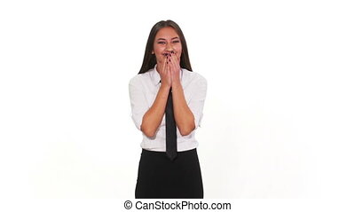 Happy girl laughing against a white background