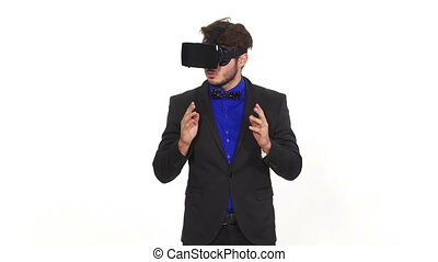 Amazed young man wearing virtual reality glasses