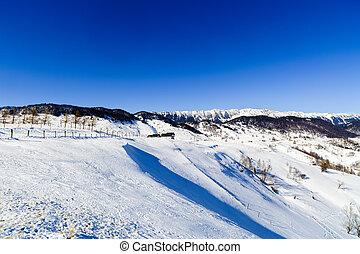 Winter landscape with Piatra Craiului Mountains, Romania.