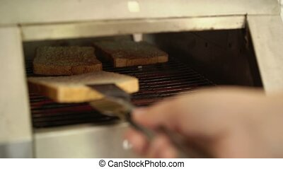 Woman using toaster in buffet at resort