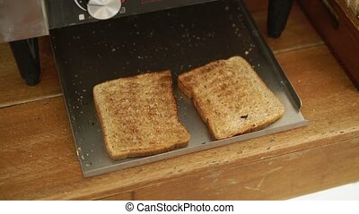 Fryed bread in toaster cooking