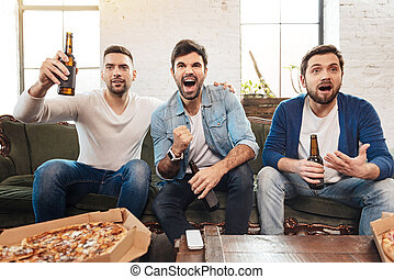 Handsome bearded man raising a bottle of beer - Reason to...