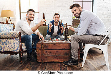 Cheerful positive men playing card games - Pleasant...