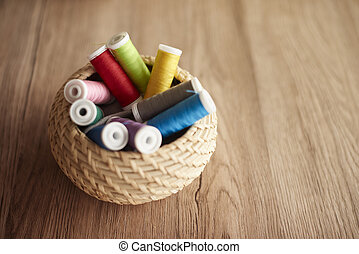 Colorful thread spools in the basket