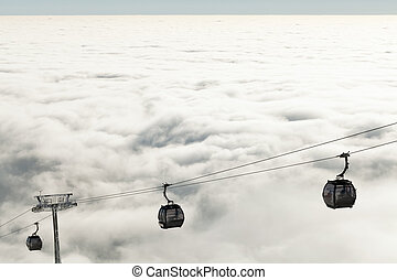 New cable cars going up and down the mountains at a winter...