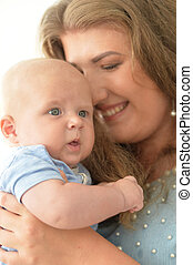 mother with her baby boy close up portrait