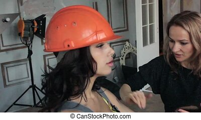 Fashion photo shoot with sexy female miner worker with...