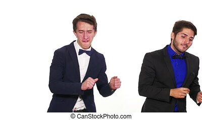 Trendy elegant young guys dancing