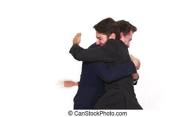 Two elegant dressed men celebrating success together