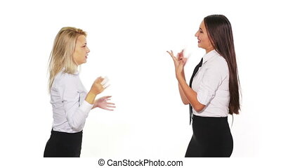 Two female colleagues talking when a male colleague with a smart phone passes by