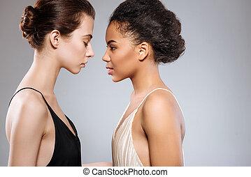 Two sensual beautiful women facing each other