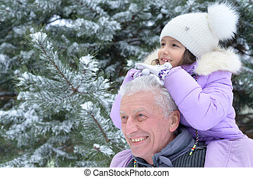 grandfather with granddaughter smiling