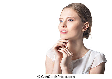 close up portrait of beautiful young woman, posing against...