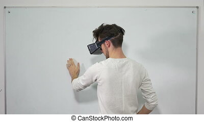 Student entering virtual reality world with VR glasses and...