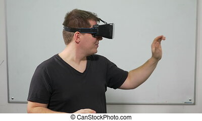 Guy experiencing video game in virtual reality with special...
