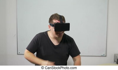 Happy young man dancing with VR 3d glasses
