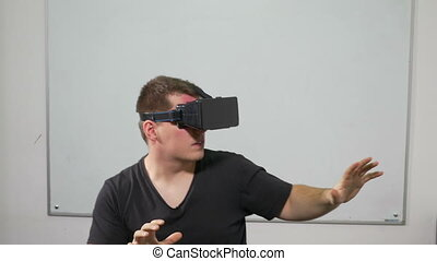 Man playing a game using virtual reality glasses