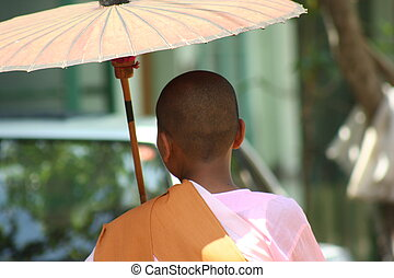 Myanmar women monks with umbrella