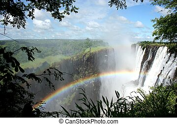 Victoria Falls with rainbow - The Victoria Falls or...