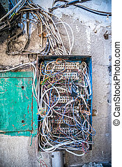 Old electrical box with a mess of wires