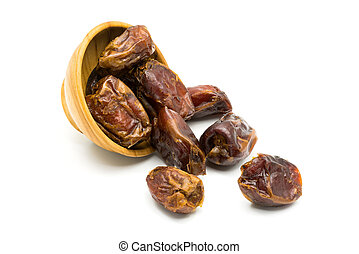 ied dates fruit and a wooden bowl - Dried dates fruit and a...