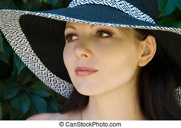Pretty woman in hat portrait