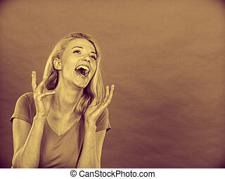 Blonde woman being happy and screaming