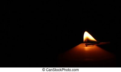 candle arson fire - Big single candle burning in the center...