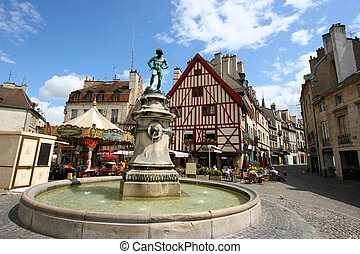 Dijon, France - Famous fountain, characteristic houses and...