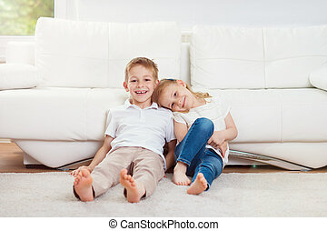 Portrait of little brother and sister having fun together at...