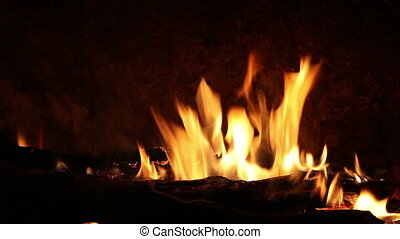 Bonfire with wood burning on a black background