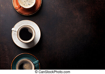 Coffee cups on old kitchen table. Top view with copyspace...