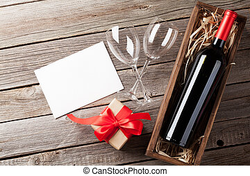 Valentines day greeting card. Red wine and gift box on...