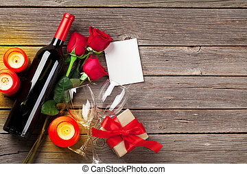 Valentines day greeting card, red rose flowers, wine and...