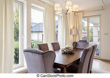 Dining room with big, wooden table - Modern dining room with...