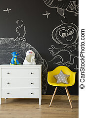 Commode at blackboard background - Commode and yellow chair...