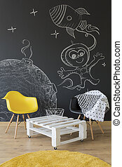 Minimalistic table with chairs in boy astronaut room