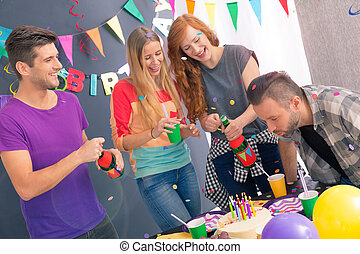Man blowing out the candles - Young man blowing out the...