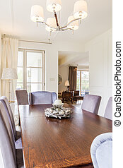 Wooden dining table with comfy chairs - Stylish wooden...