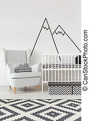 Room with cot and armchair - Bright room corner with cot and...