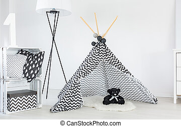 Tipi for baby boy in bright room interior