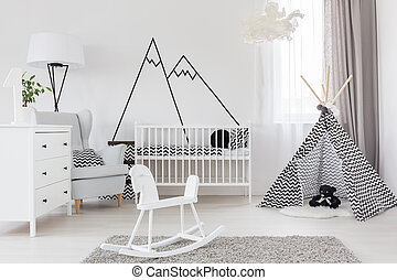Room with cockhorse and crib - White baby room with...