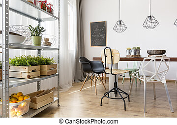 Dining area with rack - Bright dining area with rack and...