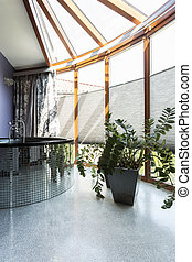 Sophisticated silver bathroom with large windows - Elegant...