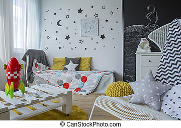 Room interior with cosmic motives and toys